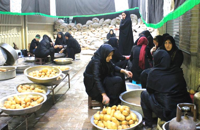 Devotees preparing food for guests
